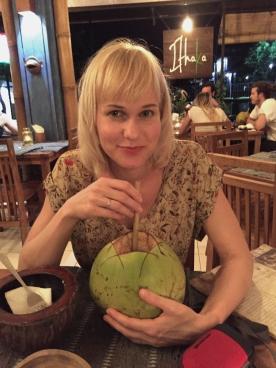 Marika drinking coconut